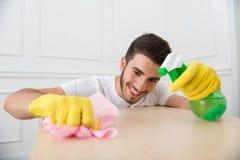 Hausmeister, der Sie vom Schmutz beraubt Stockbild