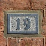 Hausnummer 19 lizenzfreie stockbilder