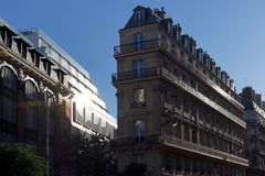 Haussmann buildings in Paris street. Haussmann building facades in Paris street royalty free stock images