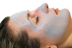 Haut der Frauen mit einer Gesichtsmaske Stockbild
