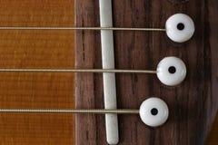 Haut proche de guitare Photographie stock libre de droits