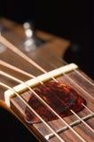 Haut proche de guitare Photo stock