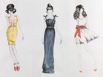 Haute couture. Hand drawn fashion sketch. women in colored dresses. watercolor and pencil drawing Stock Images