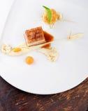 Haute cuisine, bistecca del Confit della carne di maiale con una patata fotografia stock