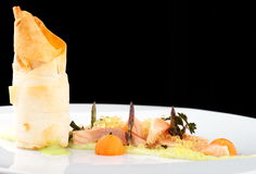 Haute cuisine, pink salmon fillet with caviar Stock Photos
