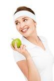 Haute jeune femme principale de portrait jugeant la pomme verte d'isolement sur le wh Images libres de droits
