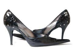 Hautes chaussures gîtées femelles de mode d'isolement sur le blanc Image libre de droits