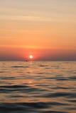 Hav och solnedgång Arkivbild
