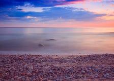 Hav på soluppgång med en lång exponering Arkivbilder