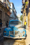Street scene with an old rusty american car in Havana Stock Images