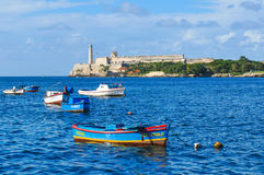 Havana Bay, Cuba. Havana, Cuba - December 19, 2016: Colourful fishing boats are anchored in Havana Bay, Cuba Stock Photography