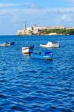 Havana Bay, Cuba. Havana, Cuba - December 19, 2016: Colourful fishing boats are anchored in Havana Bay, Cuba Stock Images