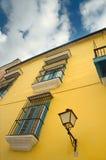 Havana building facade. Detail of yellow building facade under tropical blue sky in Old Havana royalty free stock photography