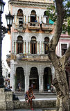 Havana City. Cuba. Havana, Cuba - January 5, 2016: Typical scene of one of streets in the center of La Havana - colonial architecture, people walking around Stock Photography