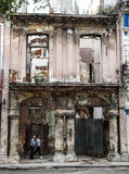 Havana City. Cuba. Havana, Cuba - January 5, 2016: Typical scene of one of streets in the center of La Havana - colonial architecture, ruins, people walking Stock Photo