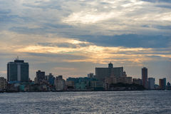 Havana City Skyline in Sunset, Cuba. Malecon and Havana city skyline. The landmark is the favorite meeting place for tourists and locals Stock Photo