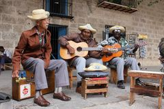 Havana,Cuba. FEV 24: street musicians singing tradicional cuba songs  FEV 24, 2010 in Royalty Free Stock Photo