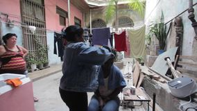 Havana, Cuba. According to the new laws in Cuba small private business are legal. Like those `hair salon` in the home yard