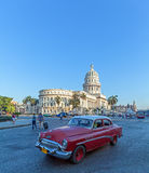 HAVANA, CUBA - APRIL 2, 2012: Black  car in front of Capitolio Royalty Free Stock Images