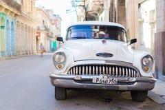 HAVANA, CUBA - APRIL 14, 2017: Closeup of classic vintage car in Old Havana, Cuba. The most popular transportation for. View of yellow classic vintage car in Old Royalty Free Stock Photos