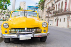 HAVANA, CUBA - APRIL 14, 2017: Closeup of yellow classic vintage car in Old Havana, Cuba. The most popular. View of yellow classic vintage car in Old Havana Royalty Free Stock Photography