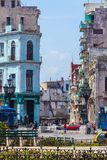HAVANA, CUBA - APRIL 1, 2012: Cubans walk the streets of the old. Town with the destroyed beautiful houses Stock Images