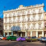 HAVANA, CUBA - APRIL 2, 2012: Cubans walk the streets of the tow. HAVANA, CUBA - APRIL 2, 2012: Cubans walk the streets of the old town near Hotel Inglaterra Royalty Free Stock Photo