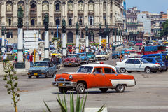 HAVANA, CUBA - APRIL 1, 2012: Heavy traffic with taxi bikes and Stock Photos