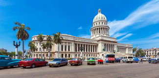 HAVANA, CUBA - APRIL 1, 2012: Many retro cars parked in front of Royalty Free Stock Image