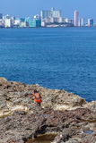 HAVANA, CUBA - APRIL 1, 2012: Native boy and modern district Vedado Royalty Free Stock Photo