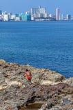 HAVANA, CUBA - APRIL 1, 2012: Native boy and modern district Vedado Royalty Free Stock Photo