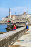 HAVANA, CUBA - APRIL 1, 2012: Native fishermen in front of Moro Stock Photography