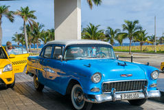 HAVANA, CUBA - APRIL 7, 2016: Old classic American cars rides in Royalty Free Stock Photo
