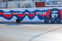HAVANA, CUBA - APRIL 2, 2012: Propaganda graffiti and trash can. HAVANA, CUBA - APRIL 2, 2012: Propaganda graffiti from Jose Marti, Amor cuerdo, no es amor, or stock image