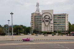 Havana, Cuba - April 13, 2017: Revolution square in the center of Havana with featuring an iron mural of Camilo Cienfuegos` face. In the Ministry of royalty free stock photography