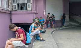 HAVANA, CUBA - APRIL 5, 2016: Young people on a city square usin Royalty Free Stock Image