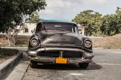 Havana, Cuba - Aug. 2017: Old and rusty car Oldsmobile - Taxi in the surburb of Havana royalty free stock image