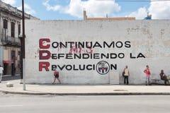 HAVANA, CUBA, AUG 16, 2016: Revolutionary statement on a mural `We`re still defending the revolution` Stock Images