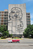 HAVANA, CUBA, AUG 16, 2016: Vintage car drives in front of iconic Che Guevara`s mural at Revolution Square Royalty Free Stock Images