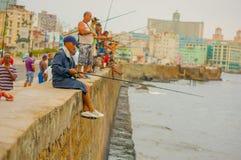 HAVANA, CUBA - AUGUST 30, 2015: Local men fish on Stock Images