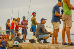 HAVANA, CUBA - AUGUST 30, 2015: Local men fish on Royalty Free Stock Images