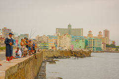 HAVANA, CUBA - AUGUST 30, 2015: Local men fish on Royalty Free Stock Photography