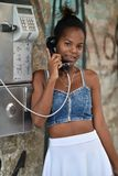 Havana, Cuba, August 14th, 2018: Beauty cuban girls speaking over the public phone. In Havana royalty free stock photos