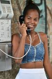 Havana, Cuba, August 14th, 2018: Beauty cuban girls speaking over the public phone. In Havana stock photos