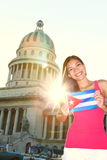 Havana, Cuba - Capitol and tourist with cuban flag. In front of the National Capitol Building. Cuba travel concept photo with beautiful smiling happy woman Royalty Free Stock Images