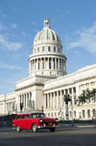 Havana Cuba Capitolio Building with Car. Classic red American car passes in front of the Capitolio building in Central Havana Stock Photography