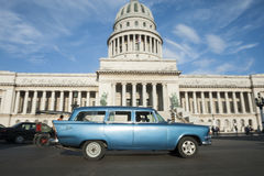 Havana Cuba Capitolio Building with Vintage Car. Classic American Cuban station wagon taxi car passes in front of the Capitolio building in Central Havana stock images