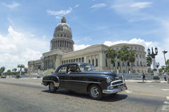 Havana, Cuba. A classic american car passing in front of the Capitolio in Havana, Cuba Stock Photos