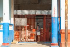 HAVANA,CUBA.Classical authentic old grocery store in city Havana.Cuban stands in front of the counter royalty free stock image