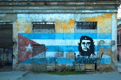 Street art with Che Guevara and cuban flag royalty free stock images